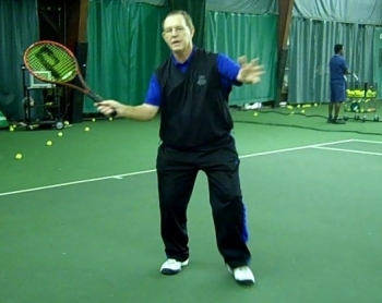 Coach Des demonstrates a forehand volley