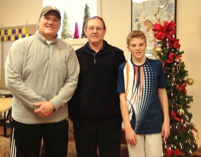 The winners of the 2013 New Year's Day Family Challenge - Mark and Nathan Branaman with Des Evans