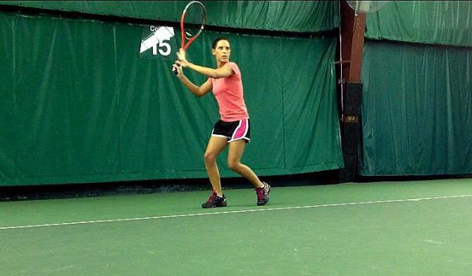 Loading on the right foot for a semi-open stance forehand