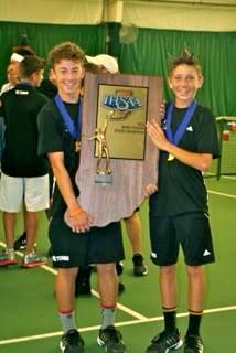 Indiana State Champions JJ Kroot and JT Wynne proudly hold the IHSAA Trophy