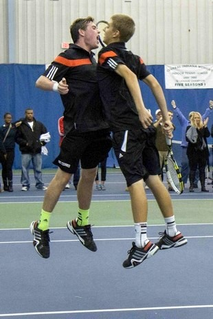 Patrick and Will celebrate their victory with Bryan-like chest bump