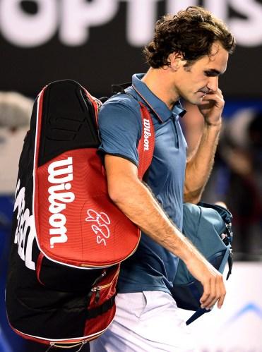 Roger Federer departs after encountering an on form Nadal