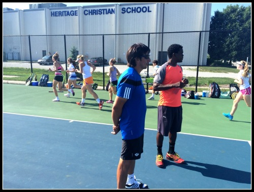 Coaches Hector Clavijo and Sule Ladipo running their elite players' group