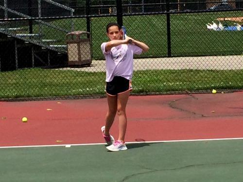 Hadley freezes her forehand follow through