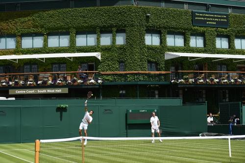 Roger Federer practising on court 5 with coach Stefan Edberg
