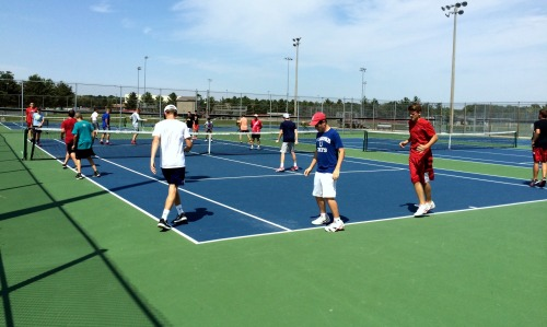 The boys tennis team working on their conditioning at New Palestine
