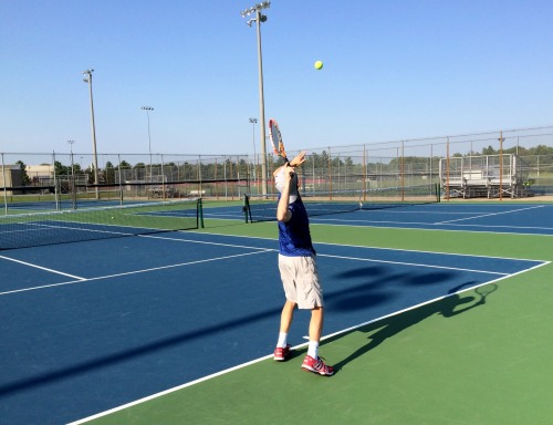 New Palestine's Matthew True working on his serve